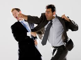 2 men dressed in suits are fighting with fists