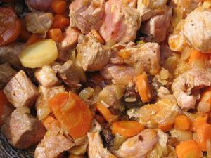 lightly cooked chunks of meat and vegetables for dog food