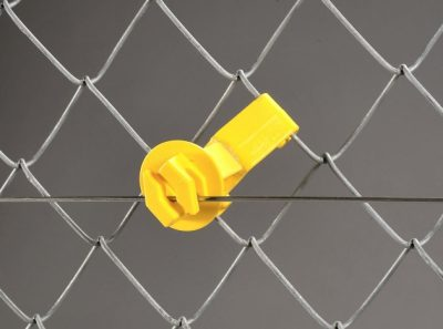 Yellow plastic electric fence insulator for chain link fencing