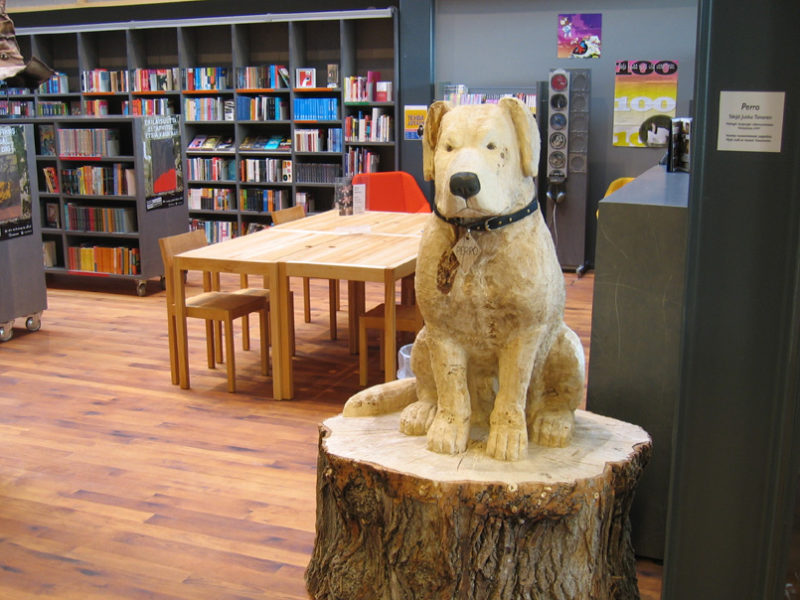 dog carving in a library